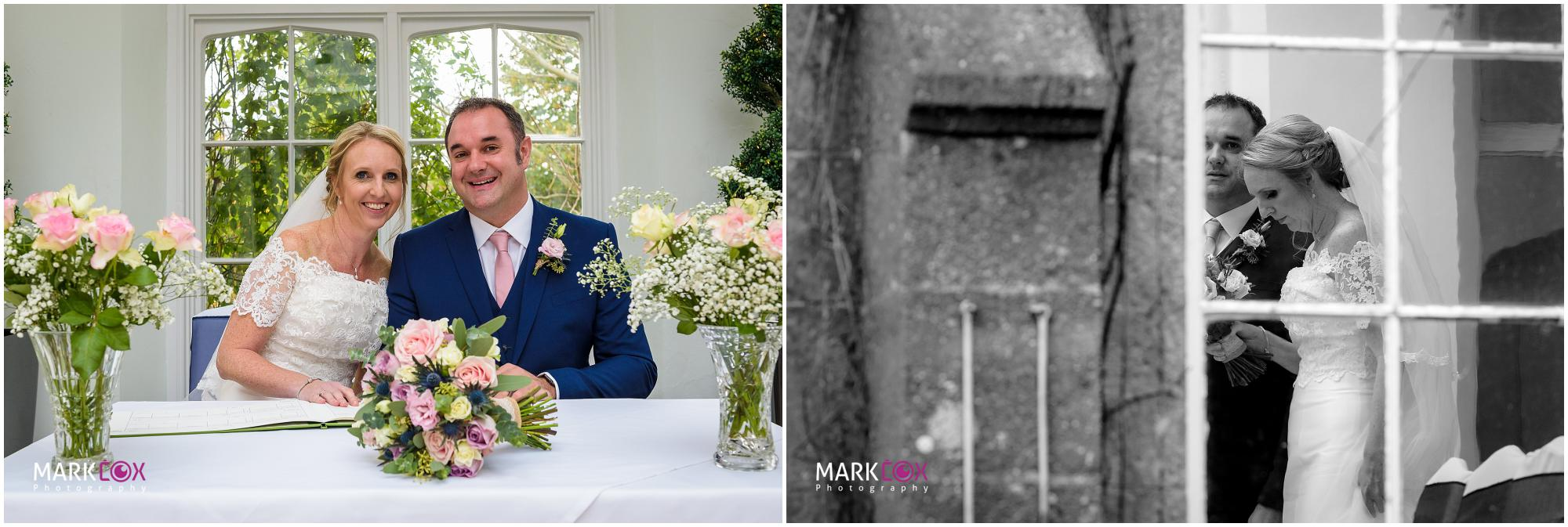 Signing the register at St Audries Park - Somerset Wedding Photographer-001